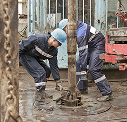 down hole oil drilling two men